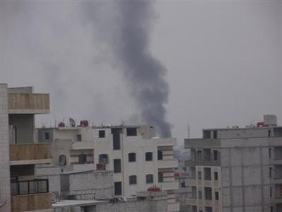 Smoke rises from the suburb of Erbeen in Damascus, January 29, 2012. Around 2,000 Syrian troops backed by tanks launched an assault to retake Damascus suburbs from rebels on Sunday, activists said, a day after the Arab League suspended its monitoring mission in Syria because of worsening violence. REUTERS/Handout