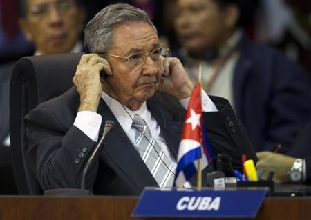 Cuba's President Raul Castro attends to the plenary session of the summit of leaders from the 33-member Community of Latin American and Caribbean States (CELAC) in Caracas December 2, 2011. REUTERS/Carlos Garcia Rawlins