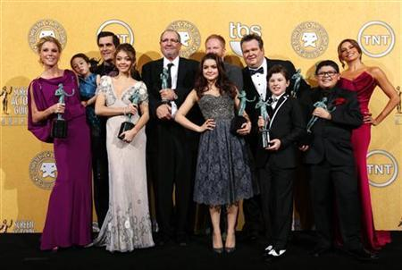 The cast of ''Modern Family'' pose backstage after the show won outstanding performance by an ensemble in a comedy series at the 18th annual Screen Actors Guild Awards in Los Angeles, California January 29, 2012. REUTERS/Mike Blake