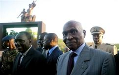 Senegalese President Abdoulaye Wade (R) arrives at the reborn monument to welcome Haitian students in the capital Dakar, October 13, 2010. REUTERS/Émilie Régnier
