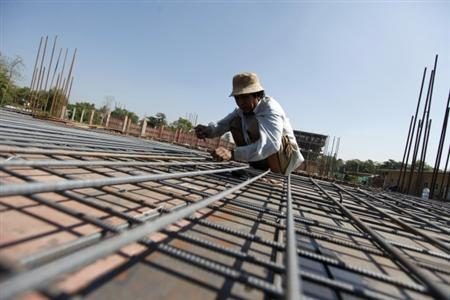 A labourer works at a construction site in Yangon January 24, 2012. REUTERS/Soe Zeya Tun