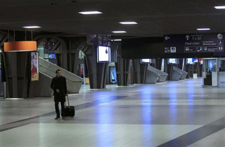 A passenger walks in an empty train station in Brussels during a nationwide strike January 30, 2012. REUTERS/Yves Herman