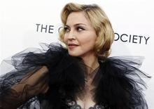 "<p>Madonna poses for photographers as she arrives for the premiere of the film ""W.E."" which she directed, at the Ziegfeld Theater in New York City, January 23, 2012. REUTERS/Mike Segar</p>"