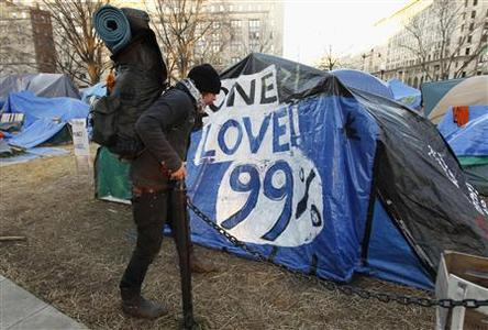 An Occupy DC demonstrator packs up his camping gear, in compliance with new restrictions, at McPherson Square in Washington January 30, 2012.   REUTERS-Kevin Lamarque