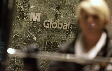 A woman leaves the office complex where MF Global Holdings Ltd have an office on 52nd Street in midtown Manhattan in this October 29, 2011 file photo. REUTERS/Andrew Kelly