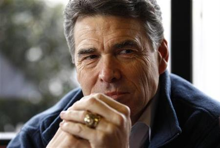 Rick Perry sits down for lunch at The Drive-In Restaurant in Florence, South Carolina, January 17, 2012. REUTERS/Jim Young