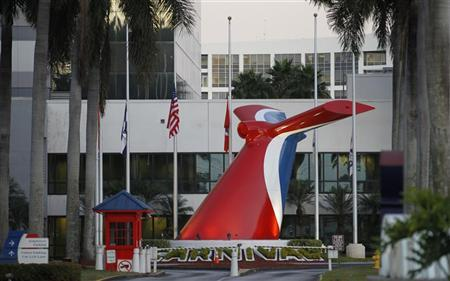 Flags are shown at half-mast outside the headquarters of Carnival Cruise Lines in Doral, Florida, January 17, 2012. Carnival is the parent company of Costa, operator of the Costa Concordia which was grounded off the coast of Italy.   REUTERS/Joe Skipper