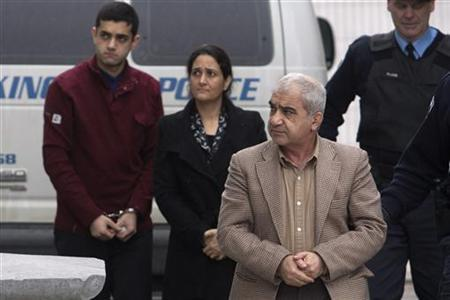 Mohammad Shafia (front), his wife Tooba Mohammad Yahya (middle) and their son Hamed arrive at the Frontenac County Courthouse in Kingston, Ontario January 26, 2012. REUTERS/Lars Hagberg