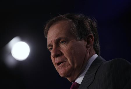 New England Patriots head coach Bill Belichick answers a question during a news conference for the Super Bowl XLVI in Indianapolis January 30, 2012. REUTERS/Jim Young