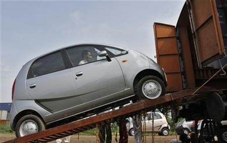 A Tata Motors Nano car is loaded onto a goods train for shipment at Sanand railway station in Gujarat September 1, 2011. REUTERS/Amit Dave/Files/Files
