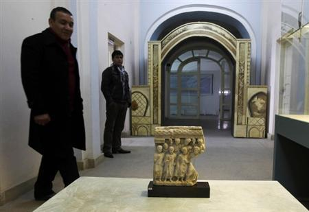 An Afghan specialist looks at an ancient pre-Islamic sculpture that was returned to Afghanistan at the Afghan National Museum in Kabul January 30, 2012. REUTERS/Omar Sobhani