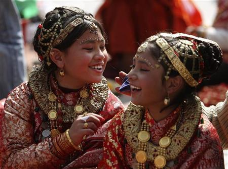 Girls get ready for ''Ihi'', their first marriage ceremony, in Kathmandu January 30, 2009. REUTERS/Gopal Chitrakar