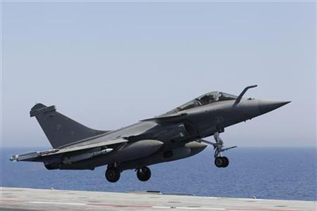 A Rafale fighter jet makes a catapult launch off the flight deck, where in two seconds the jet goes from 0 to 250 kms per hour, aboard France's flagship Charles de Gaulle aircraft carrier March 28, 2011. REUTERS/Benoit Tessier/Files