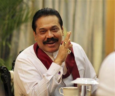 Sri Lanka's President Mahinda Rajapaksa speaks during a meeting with foreign correspondents at his office in Colombo January 31, 2012. REUTERS/Presidential Media Office/Handout