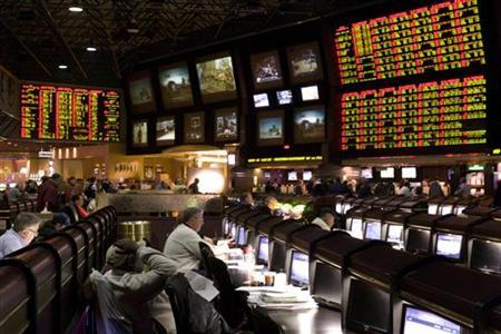 Proposition bets (R) for Super Bowl XLV are posted at the race and sports book in the Las Vegas Hilton in Las Vegas, Nevada January 27, 2011. REUTERS/Las Vegas Sun/Steve Marcus