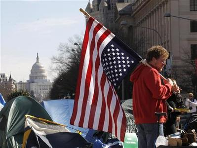 An Occupy Washington protester flies a U.S. flag upside down, usually flown as a sign of distress, at Freedom Plaza in Washington January 30, 2012.  REUTERS/Jason Reed