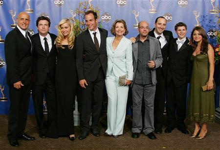 The Cast of Arrested Development smile at the 56th annual Primetime Emmy Awards in Los Angeles, September 19, 2004. They won an Emmy for best comedy series. REUTERS/Lucy Nicholson