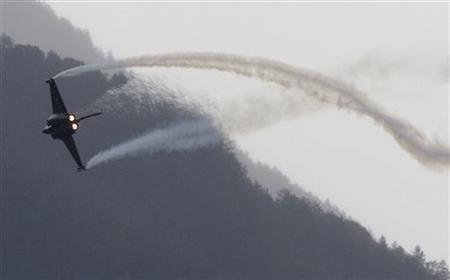 The Dassault Rafale aircraft performs during the Air Show in Sion September 17, 2011. REUTERS/Denis Balibouse