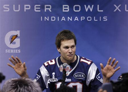 New England Patriots quarterback Tom Brady answers questions during media day for the NFL Super Bowl XLVI in Indianapolis January 31, 2012. REUTERS/Jim Young