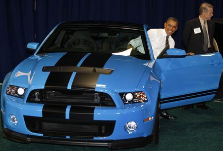U.S. President Barack Obama sits in a Ford Mustang Shelby GT-500 at the 2012 Washington Auto Show at the Walter E. Washington Convention Center in Washington, January 31, 2012.     REUTERS/Larry Downing