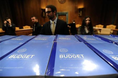 Senate Budget Committee staff members stand ready to hand out stacks of U.S. President Barack Obama's proposed 2012 federal budget on Capitol Hill in Washington, February 14, 2011.  REUTERS/Jonathan Ernst