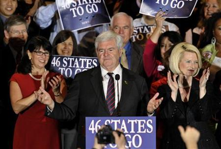 U.S. Republican presidential candidate and former Speaker of the House Newt Gingrich is accompanied by his wife Callista (R) as he addresses supporters at his Florida primary night rally in Orlando, Florida January 31, 2012. REUTERS/Octavian Cantilli
