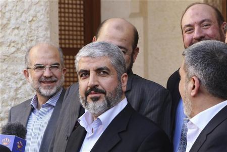 Hamas leader Khaled Meshaal (C) smiles at reporters after his meeting with Jordan's King Abdullah at the Royal Palace in Amman January 29, 2012. REUTERS/Ali Jarekji