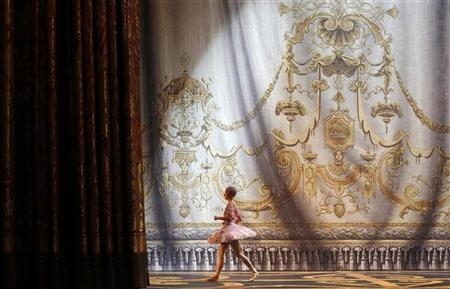 Bolshoi ballet dancer Maria Alash leaves the stage during a rehearsal of Tchaikovsky's ballet ''The Sleeping Beauty'' at the Bolshoi Theatre in Moscow November 16, 2011. REUTERS/Denis Sinyakov