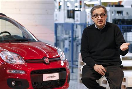 Sergio Marchionne, CEO of Fiat and Chrysler Group, speaks to journalists during a presentation of the new Panda car at the Fiat plant in Pomigliano D'Arco, near Naples, December 14, 2011.  REUTERS/Alessandro Bianchi