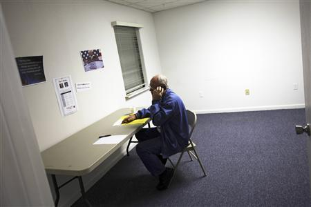 A volunteer for Newt Gingrich speaks on a telephone at the Newt 2012 Polk County headquarters office in Lakeland, Florida January 31, 2012.  REUTERS/Shannon Stapleton