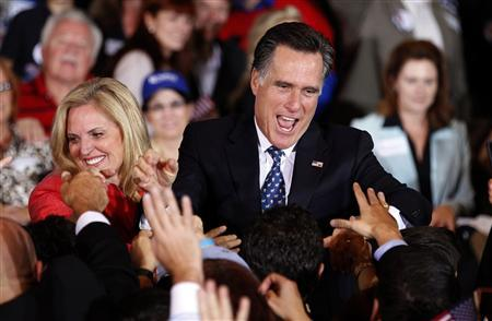 U.S. Republican presidential candidate and former Massachusetts Governor Mitt Romney and his wife Ann (L) greet supporters at his Florida primary night rally in Tampa, Florida January 31, 2012.  REUTERS/Mike Carlson