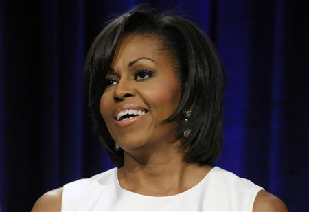 U.S. first lady Michelle Obama smiles during remarks to the Democratic National Committee's Women's Leadership Forum in Washington, May 19, 2011. REUTERS/Jonathan Ernst