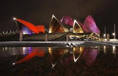 <p>The Sydney Opera House is reflected in a pool of rain water as it is lit during the Vivid Sydney Festival in Sydney May 27, 2010. REUTERS/Tim Wimborne</p>