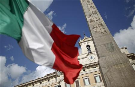 An Italian flag waves in front of the Montecitorio palace before the start of a finances vote in downtown Rome November 8, 2011. REUTERS/Tony Gentile