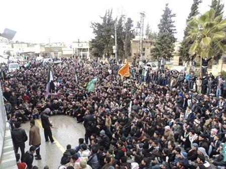 Demonstrators attend a rally to protest against Syria's President Bashar al-Assad in Jerjenaz, near Idlib January 27, 2012. REUTERS/Handout