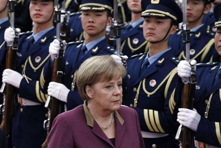 German Chancellor Angela Merkel inspects a guard of honour during an official welcoming ceremony in the Great Hall of the People in Beijing February 2, 2012.  REUTERS/David Gray