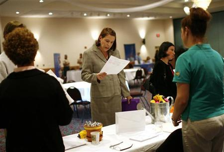 A woman reads an application at a job fair in Estero, Florida in this January 14, 2009 file photo.  REUTERS/Carlos Barria