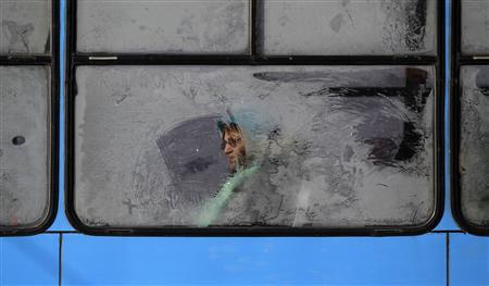 A woman is seen through a frosted tram window in central Sofia February 1, 2012. Cold weather raised Bulgaria's power consumption to a record-high 7,300 megawatts per hour on Tuesday evening, power grid operator data showed on Wednesday. The Balkan country's temperatures remain at minus 15-20 degrees Celsius during the day and minus 20-29 degrees at night for a third day and the grid operator expects increased power consumption until Saturday.    REUTERS/Stoyan Nenov