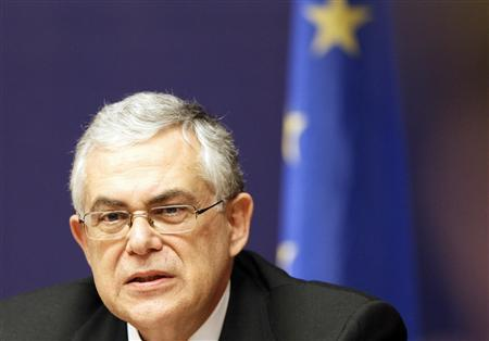 Greece's Prime Minister Lukas Papademos holds a news conference after a European Union summit in Brussels, January 31, 2012.  REUTERS/Sebastien Pirlet