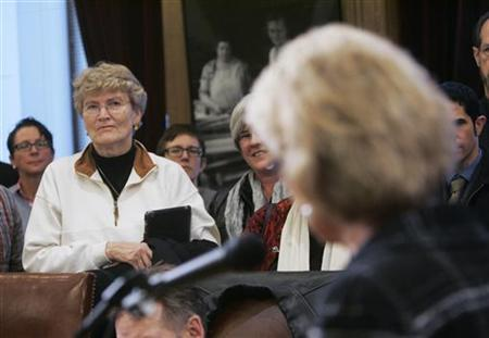 Margarethe Cammermeyer (L) listens to Washington state Governor Chris Gregoire announces her support for legislation that would legalize gay marriage in the state, in Olympia, Washington, January 4, 2012. Cammermeyer, who was a colonel in the Washington State National Guard, was discharged for admitting she was a lesbian in 1989, before being re-instated by court order in 1992 and served till her retirement in 1997. REUTERS/Robert Sorbo