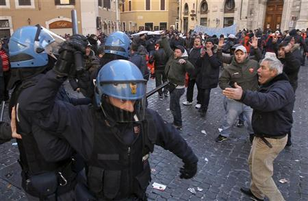 Fishermen clash with police in front of Parliament during a demonstration to protest against the government's austerity measures in Rome January 25, 2012. REUTERS/Stringer