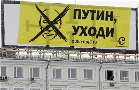 A banner, set by members of the Solidarnost (''Solidarity'') opposition movement is seen hanging on the roof of a building opposite the Kremlin across the Moskva River, as they protest against the policies conducted by Prime Minister and presidential candidate Vladimir Putin, in central Moscow February 1, 2012. REUTERS/Denis Sinyakov