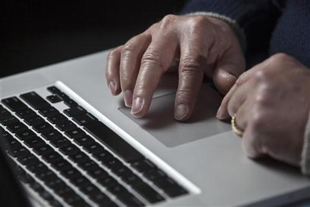 John Bumgarner, a cyber warfare expert who is chief technology officer of the U.S. Cyber Consequences Unit, a non-profit group that studies the impact of cyber threats, works on his laptop computer during a portrait session in Charlotte, North Carolina December 1, 2011.  REUTERS/John Adkisson
