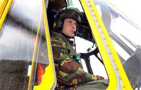 Britain's Prince William sits at the controls of a Sea King helicopter, during a training exercise at Holyhead Mountain, in Wales March 31, 2011.   REUTERS/John Stillwell/Pool