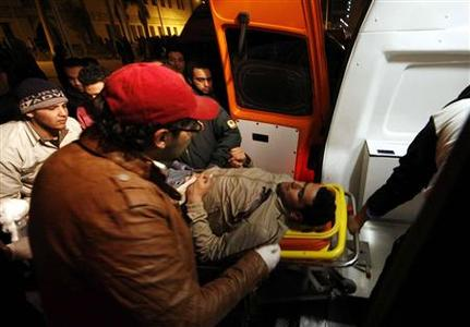 A man wounded in clashes in Port Said stadium is carried into an ambulance at Ramsis metro station in Cairo early February 2, 2012.  REUTERS/Stringer