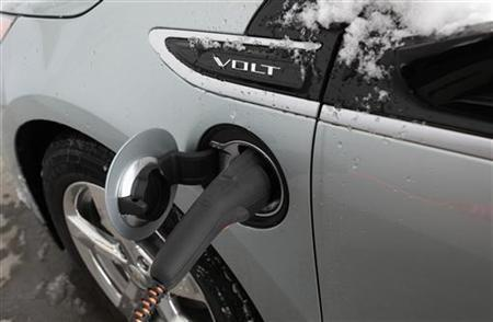 A 2012 Chevrolet Electric Volt gets charged at a charging station at a Chevrolet car sales lot in Troy, Michigan January 30, 2012. REUTERS/Rebecca Cook