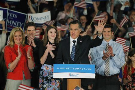 Republican U.S. presidential candidate and former Massachusetts Governor Mitt Romney stands with his wife Ann (L), their son Tagg (2nd from L), their granddaughter Allie (3rd from L) and their son Matt (R), at his South Carolina primary election night rally in Columbia, South Carolina, January 21, 2012.  REUTERS/Brian Snyder