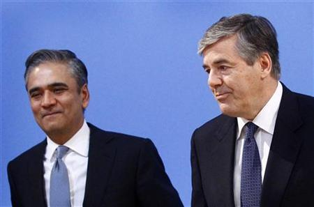 Josef Ackermann (R) outgoing CEO of Deutsche Bank AG stands next to his designated successor Anshu Jain prior to the bank's annual news conference in Frankfurt, February 2, 2012. REUTERS/Kai Pfaffenbach