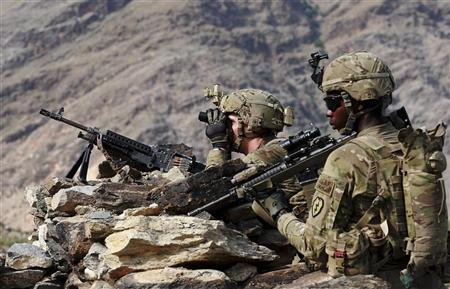U.S. Army soldiers from Charlie Company 2nd battalion 35th infantry regiment, Task Forces Bronco survey a village during a foot patrol in eastern Afghanistan Chaw Kay district in Kunar province, August 18, 2011.  REUTERS/Nikola Solic