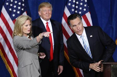 Republican presidential candidate and former Massachusetts Governor Mitt Romney (R) is endorsed by businessman and real estate developer Donald Trump at the Trump Hotel in Las Vegas, Nevada February 2, 2012. Ann Romney is at left.   REUTERS/Steve Marcus